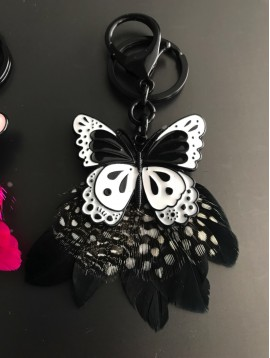 Key ring - Enamelled butterfly with feathers decoration.