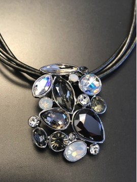 Necklace - Various rhinestones set on leather laces.