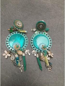 Boucles d'oreilles - Rosace avec pampilles diverses coquillages, fleurs et étoiles.