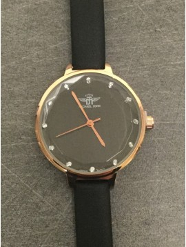 Wristwatch - Iridiscent background round faceted dial with rhinestones.