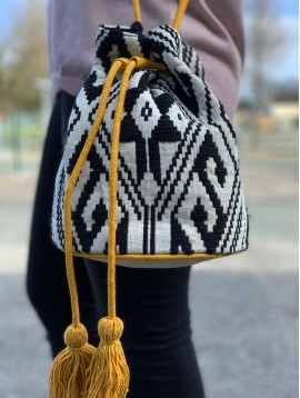 Cross body bag - Fabric style with ethnic embroided pattern with tightening lace and pom poms.