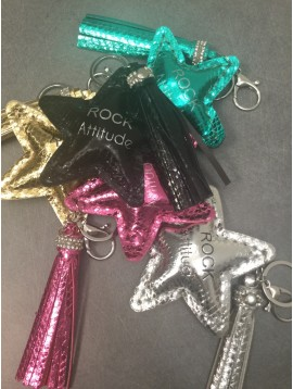 "Key ring - Star charm with ""ROCK Attitude"" phrase and pom pom."