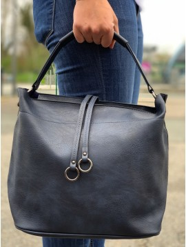 Hob bag - Plain color ribbed look with straps and rings decoration.