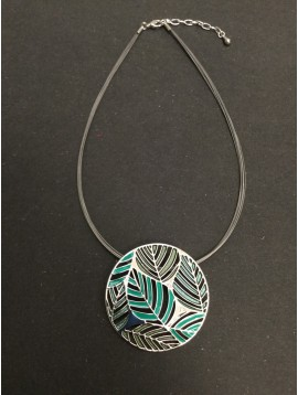Necklace - Circle charm with open work coloured leaf pattern.