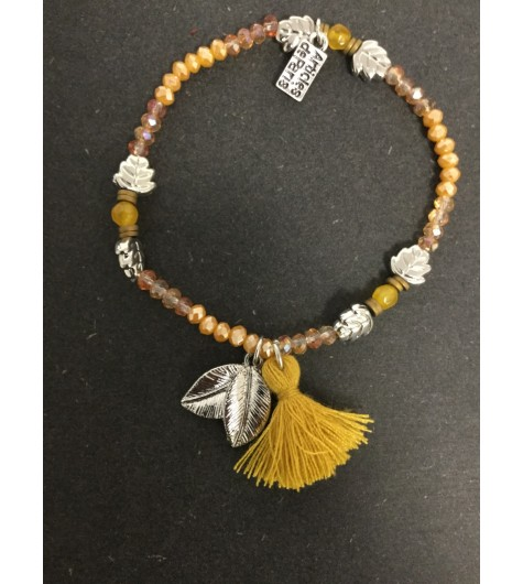Bracelet - Faceted beads with leaf and pom poms charms.