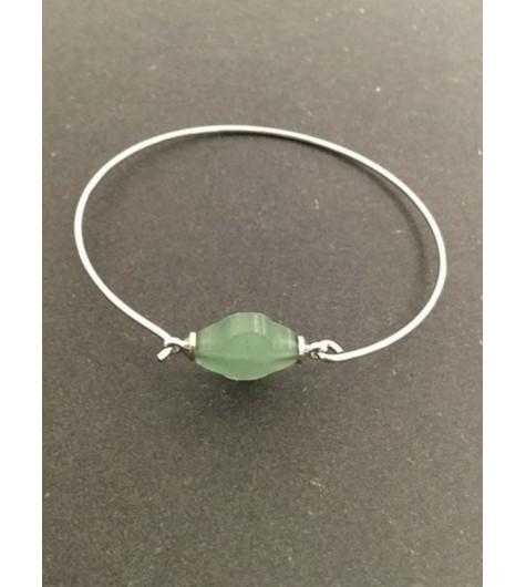 Bracelet - Thin cuff with faceted clover charm.