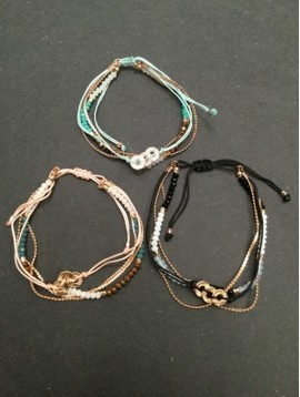 Bracelet - Sliding style multi row with metallic rings charms.