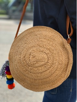 Cross body bag - Round model plain color straw with pom poms.
