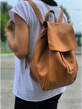 Leather backpack - Plain color full grain supple model with flap and tightening lace.