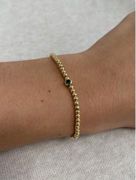 Bracelet Acier - Rang perles dorées sur cordon coulissant